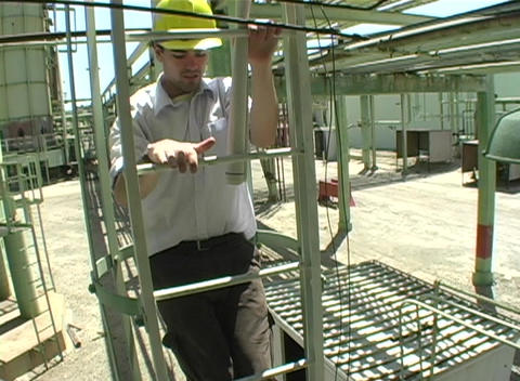 Close up of contractor descending fixed rail ladder at... Stock Video Footage