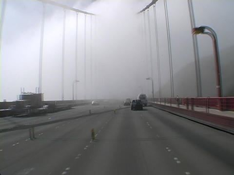 Cars drive across a Golden Gate Bridge in San Francisco Stock Video Footage