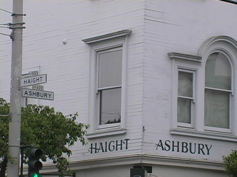 Haight and Ashbury signs are on a building in San Francisco Stock Video Footage