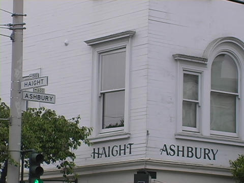 Haight and Ashbury signs are on a building in San Francisco Footage