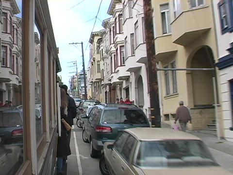 A cable car drives down the streets in San Francisco,... Stock Video Footage