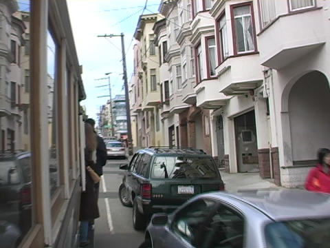 A cable car drives down the streets in San Francisco, California Footage