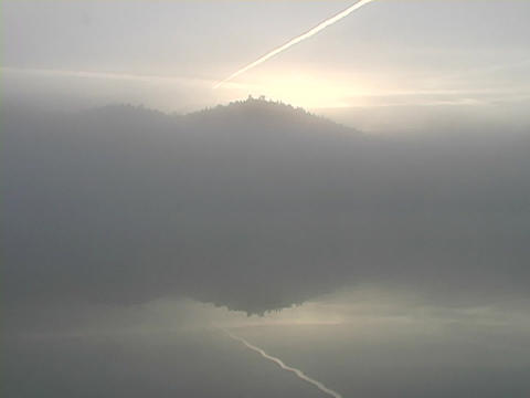 Fog covers a Mountain lake Stock Video Footage
