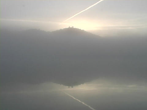 Fog covers a Mountain lake Footage
