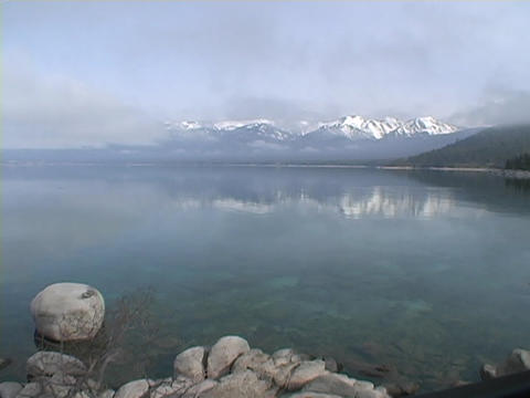Fog covers a lake over a misty morning dawn at Lake Tahoe, Nevada Footage