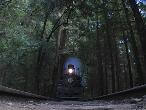 A steam passenger train passes directly over the camera Footage