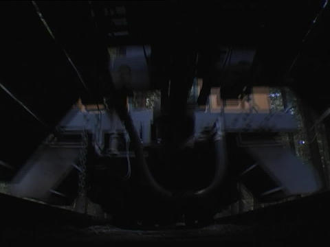 A steam passenger train passes directly over the camera Stock Video Footage