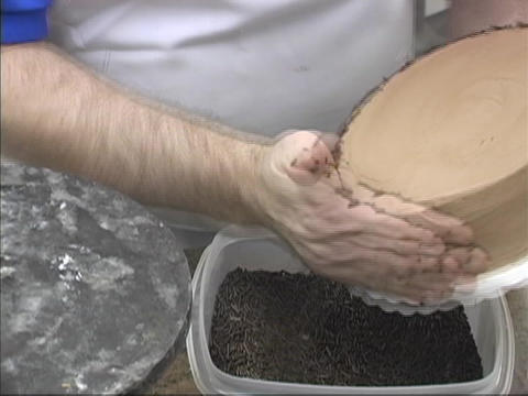 A cake is unmade by a pastry chef in a kitchen Stock Video Footage