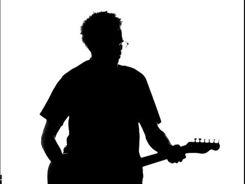 A guitarists is silhouetted while he plays Stock Video Footage