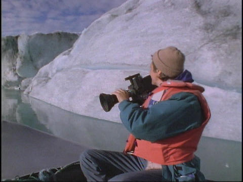A cameraman shoots video as he rides in a boat Stock Video Footage