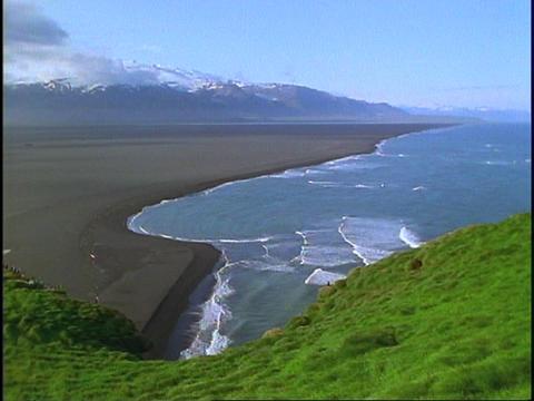Black sand lines the coastline of Iceland Stock Video Footage