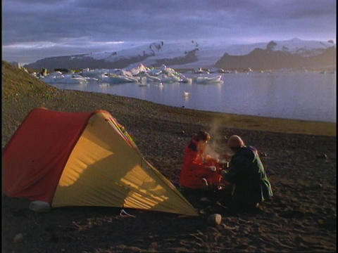 A couple camps at Arctic lake Stock Video Footage