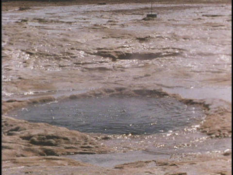 A geyser erupts at Yellowstone National Park Stock Video Footage