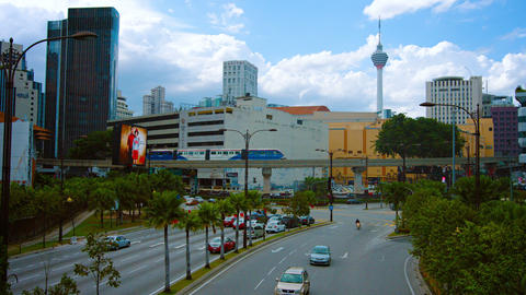 Typical urban traffic in downtown Kuala Lumpur. Malaysia. with the famous Kuala Footage