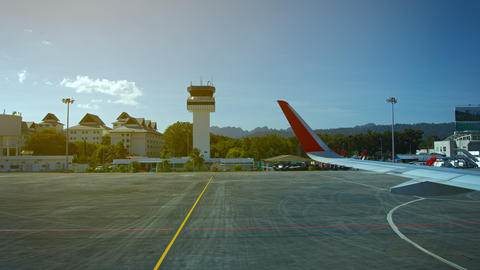 Commercial airliner. taxiing past the control tower at Langkawi International Ai Live Action