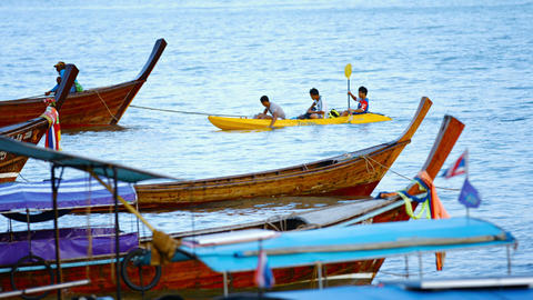 Fishermen return from fishing in a kayak off Phi Phi Island in Thailand. Southea Footage