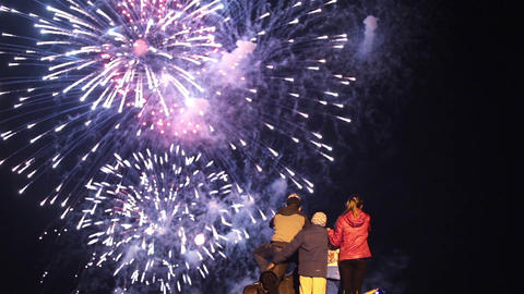 Children look at the fireworks in the night sky Footage