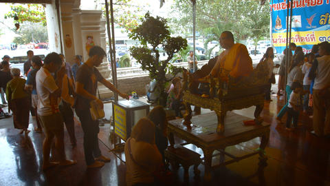 Buddhist monk and worshippers at Wat Phanan Choeng in Ayutthaya. Thailand Footage