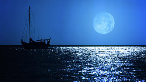 Sailboat under a Full Moon on a Tropical Sea Footage