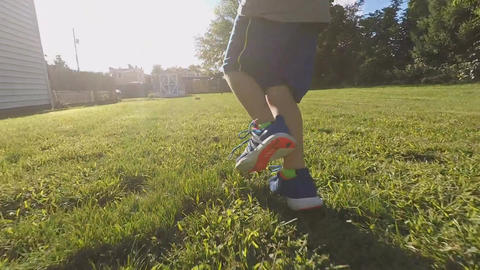 Legs of Young Boy Running (Version 3) Footage