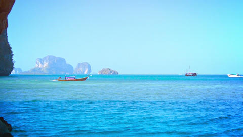 Boats Passing a Beautiful. Rocky. Tropical Beach Live Action