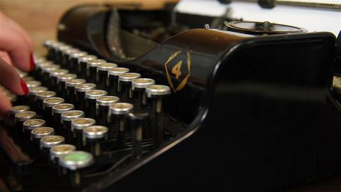 Woman Typing on Vintage Typewriter Live Action