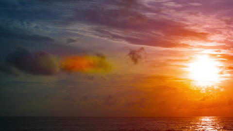 Sun Slowly Setting over a Dramatic Tropical Seascape Footage