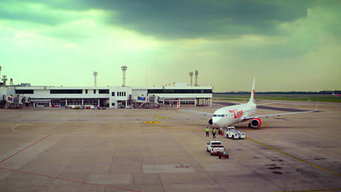 Tow Tractor Pushes Back Thai Lion Airliner at Don Mueang International Airport i Footage