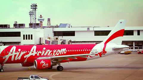 Tow Tractor Pushes Back Air Asia Airliner at Don Mueang International Airport in Footage