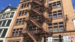 Establishing Shot of City Apartment Building with Fire Escape Footage