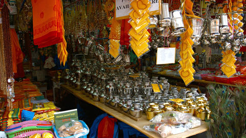 Metal Urns and Other Religious Merchandise at a Shop in Singapore's Indian Quart Footage