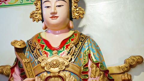 Intricately Painted Statue of the Buddha inside a Chinese Temple Footage