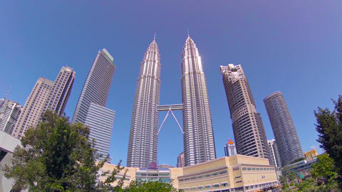 Kuala Lumpur's Iconic Petronas Twin Towers. Towering over a Park with Decorative Footage