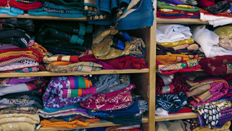 Indian Style Clothes. Folded on Shelves in a Shop Footage