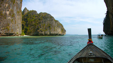 Tour Boats Pass Each Other in a Narrow Passage amongst the Rocks off Phi Phi Isl Footage