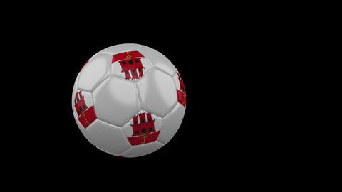 Gibraltar flag on flying soccer ball on transparent background, alpha channel Animation