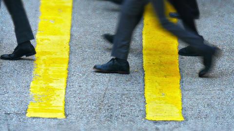 Feet and Legs of Pedestrians Crossing an Urban Street Footage