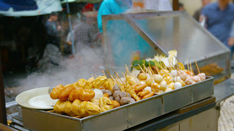 Traditional Asian Street Foods at an Outdoor Vendor's Stand Footage
