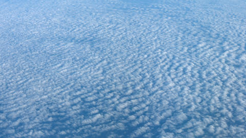 Airborne Shot of Altocumulus Clouds from Above Footage