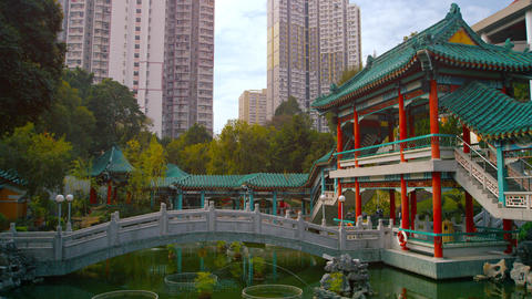 Wong Tai Sin Temple. with its Graceful Bridge over an Ornate Pond Footage