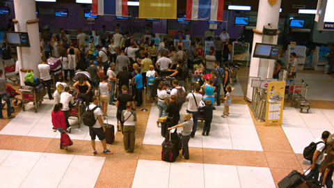 Overlooking shot of Passengers waiting in line at the Air Asia departure check-i Footage