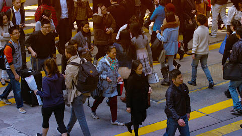 Mass of pedestrians. crossing a busy street in downtown Hong Kong. China Footage