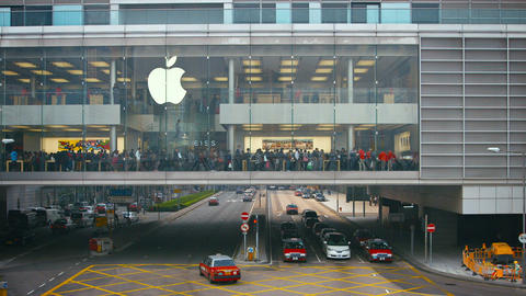 Apple Store. in a section of building suspended over a thoroughfare. Hong Kong Footage