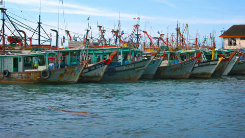 Traditional. wooden fishing boats. moored together at a pier in Borneo Footage
