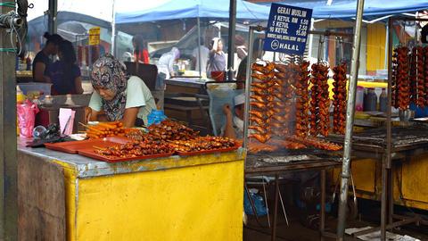 Halal barbecue vendor at an public market in Borneo. Malaysia Footage