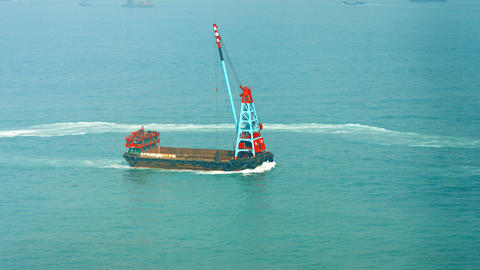 Empty barge with mounted crane assembly. cruising through the bay Footage