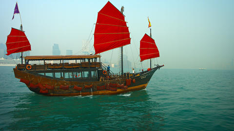Tour boat patterned after a Chinese junk. by Harbor Discovery Tours Live Action