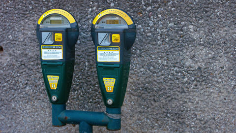 Automated. digital parking meters on a curb in downtown Macau. China Footage