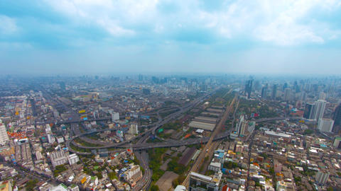 Bangkok cityscape. Thailand's capital city. on a. hazy day. with a highway junct Footage