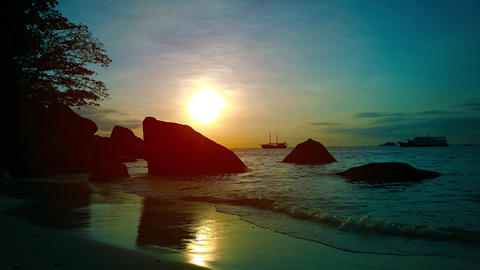 Gentle Waves on a Tropical Beach at Sunset Footage